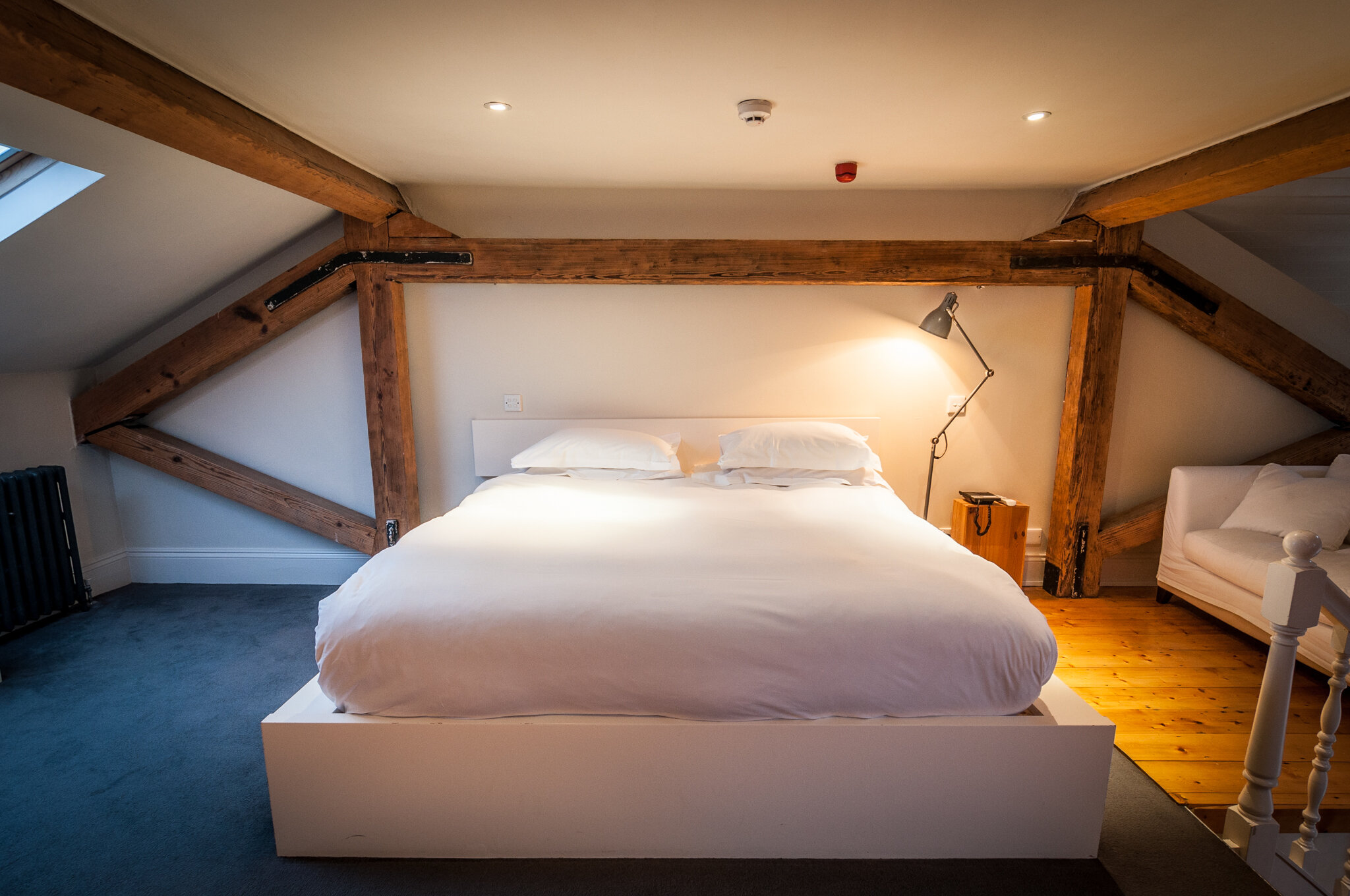 Kelly's Hotel is one of the top boutique hotels in Dublin showing room with old wood beams