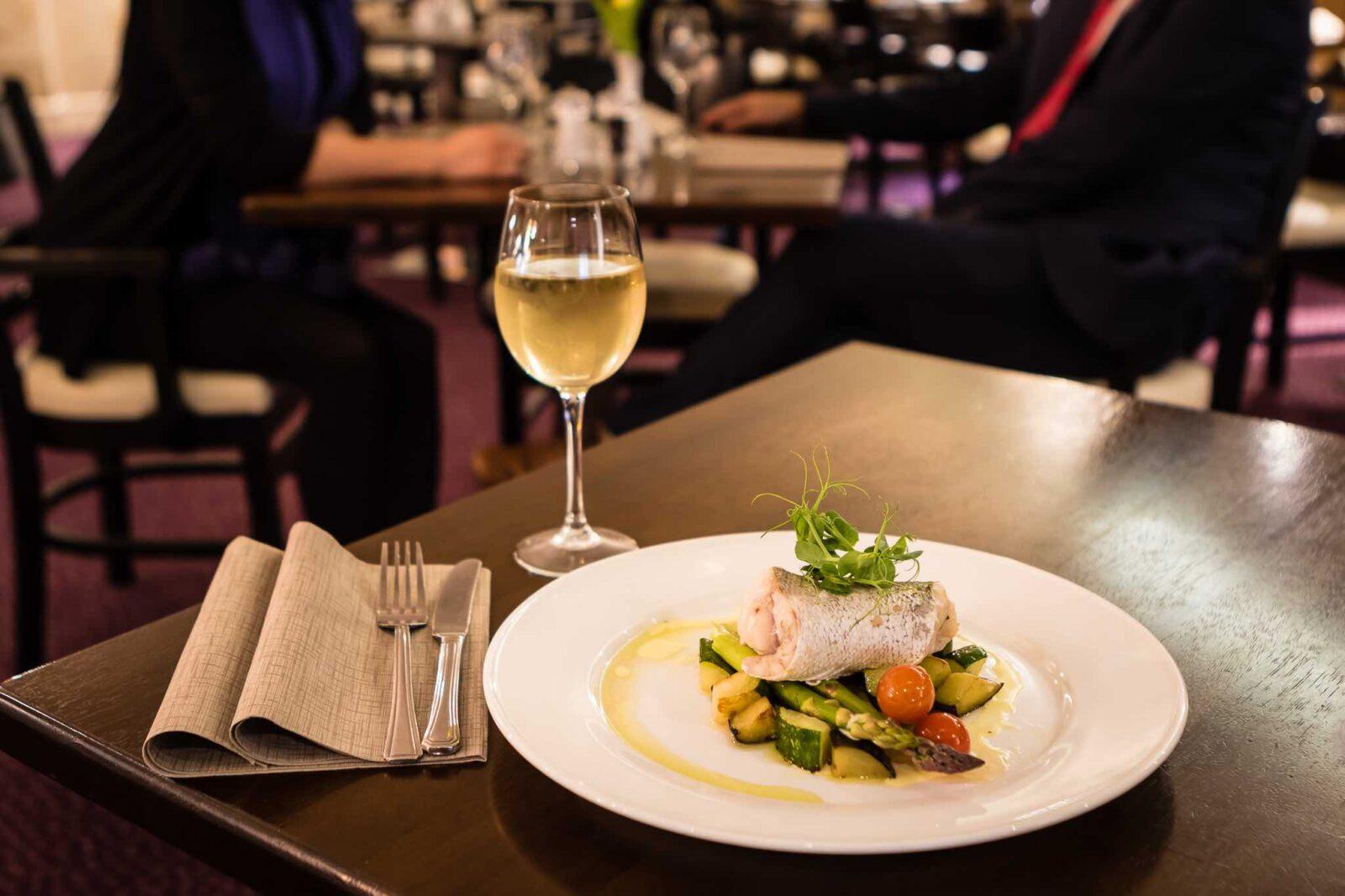 Academy Plaza Hotel wine bottle and fish dish of dublin hotel restaurants